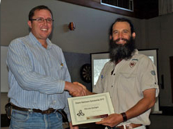 Hein van Kralingen (left) receives the award from APGA President Scott Clark at the AGM held in Macksville in August 2012